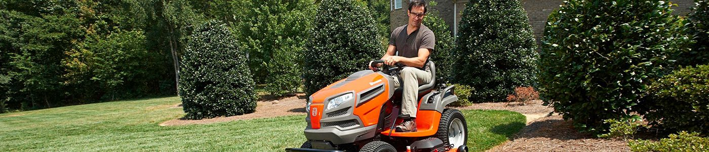 Man using Husqvarna lawn tractor