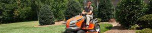 Man using Husqvarna lawn tractor