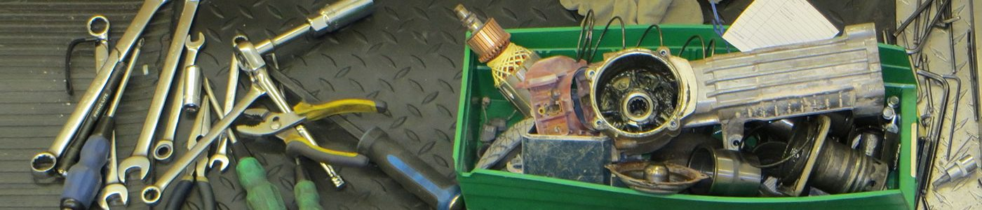 Green box containing repair tools