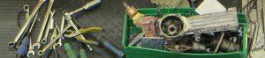 Green box containing repair tools