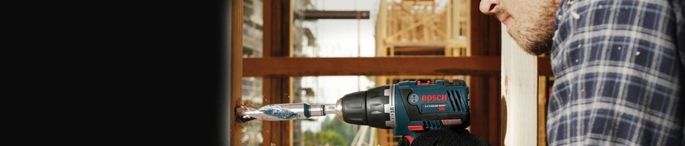 Man drilling a wall with power drill